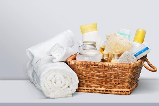 Bath towel and basket with accessories for spa on blur