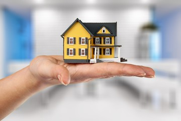 Building, mortgage, real estate and property concept - close up