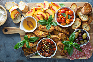Crostini board with tomatoes, peaches and dip