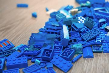 Blue details of children's designer on wooden background. Building, games, childhood, creator theme