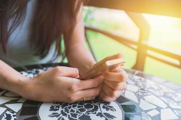 girl sitting using smartphone
