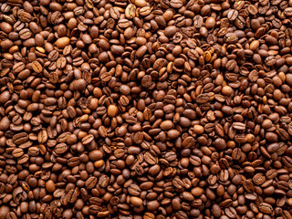 Close-up roasted coffee beans background, top view, copy space