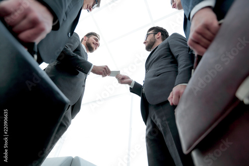 Business executive exchanging business cards stock photo and business executive exchanging business cards colourmoves