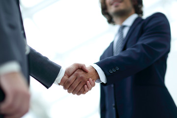 Close up image of business handshake at meeting.