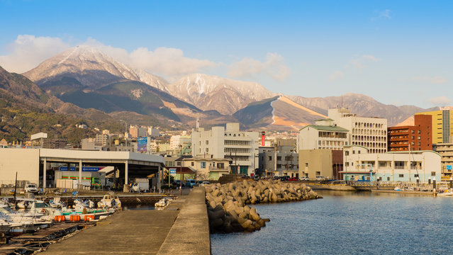 Beppu.Oita.Japan.JANUARY,30,2018.Tourists admire mountain views and beppu towns with snow cover. Make an impression not forgotten.