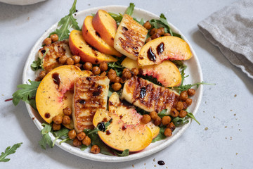 Green salad with grilled halloumi cheese and peaches
