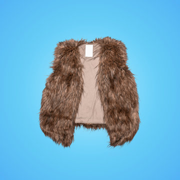 fur vest women isolated on blue background