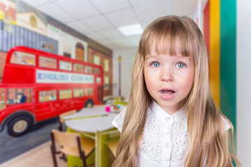 Portrait of a little school girl in a class