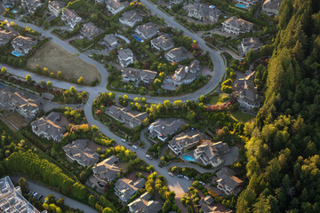 Aerial view of the big luxury homes on the hill during a vibrant sunny summer day. Taken in West Vancouver, British Columbia, Canada.