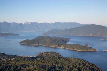 Aerial view of Gibsons, Keats Island and Howe Sound during a vibrant sunny summer day. Located in Sunshine Coast, Northwest of Vancouver, BC, Canada.