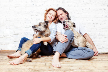 A happy married couple with their dogs, a seed portrait, love, care, friendship, devotion