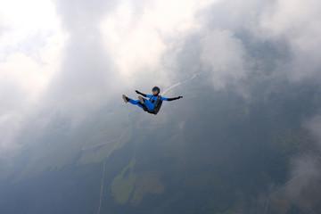 Skydiving. Girl is in the sky.