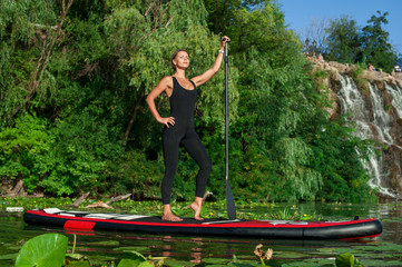 SUP Stand up paddle board woman paddle boarding