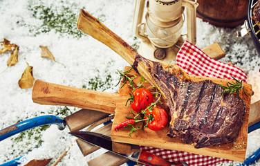 Grilled rib steak or chop with bone-in