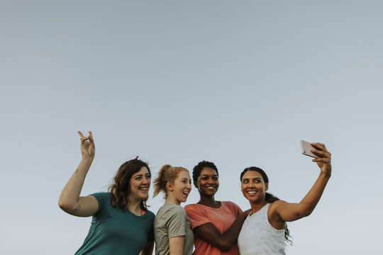 Group of diverse women taking a selfie