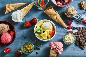 Flat lay of assorted ice cream with ingredients