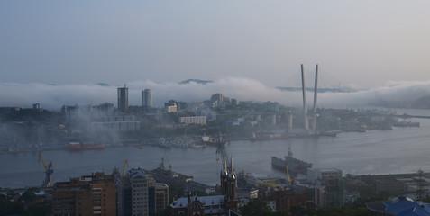 Fog over Vladivostok cityscape.