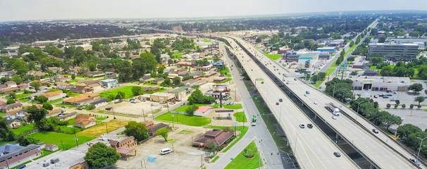 Panorama aerial view highway 90 (U.S. Route 90, US-90) and elevated Westbank expressway in suburban New Orleans, Louisiana. Massive intersection, stack interchange, road junction overpass with traffic Fotomurales