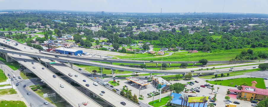 Panorama aerial view highway 90 (U.S. Route 90, US-90) and elevated Westbank expressway in suburban New Orleans, Louisiana. Massive intersection, stack interchange, road junction overpass with traffic