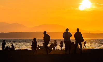 scene view of silhouette people on the beach with sunset,on summer,Seattle,usa.