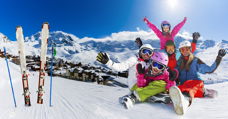Happy family enjoying winter vacations in ski resort. Playing with snow, Sun in high mountains. Winter holidays in 3 Vallees, Val Thorens, France.