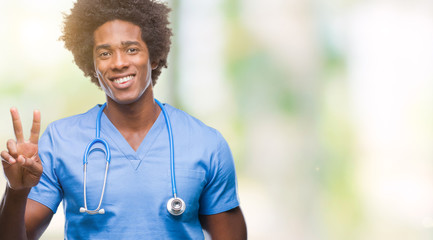 Afro american surgeon doctor man over isolated background showing and pointing up with fingers number two while smiling confident and happy.