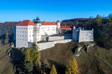 Fotobehang Kasteel Historic castle Pieskowa Skala on a rocky hill near Krakow in Poland. Aerial view in fall.