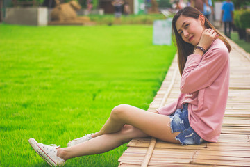 Woman sitting on a bamboo bridge