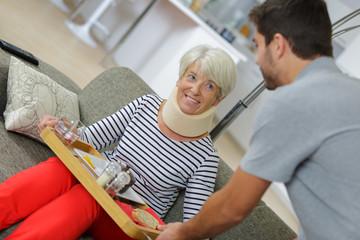 health care worker helping an elderly woman