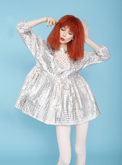 Red haired model posing in vintage dress