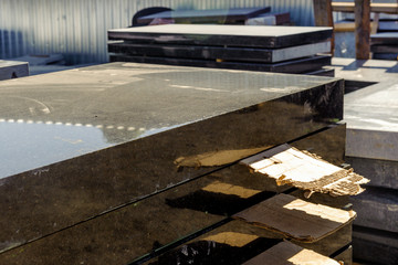 Marble and granite slabs for making tombstones in the warehouse