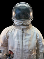 Soviet cosmonaut or astronaut or spaceman suit and helmet on black background