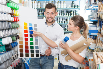 Nice man and woman  using palette scheme