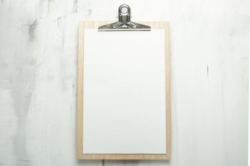 Empty white frame on the wall background. The concept of design and font inscriptions and image placement