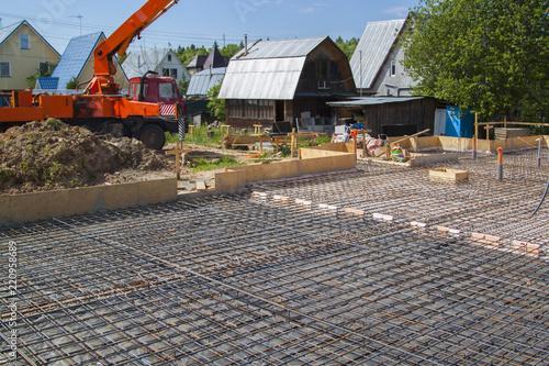 Concrete pump in anticipation of pouring concrete in a