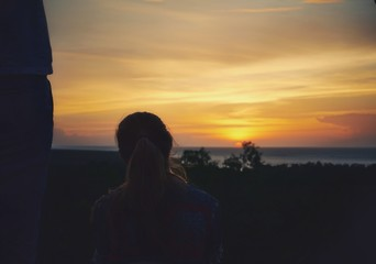 Unknown woman looking at the sunset