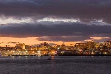 Fotobehang - night photo. View of the night city of Portland from the Bay of Portland. USA. Maine. Night Embankment.