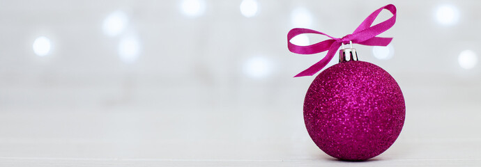 white background. pink ball. The concept of Christmas and New Ye
