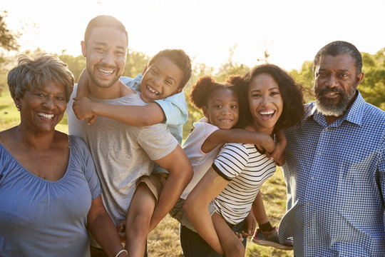 Portrait Of Multi Generation Family Enjoying Walk In Park Together
