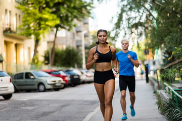 Young multi ethnic fit couple running