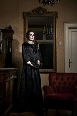 Ghostly woman standing by the armchair