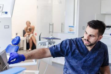 Dentist explaining something