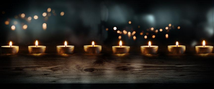 Candles on dark blue background