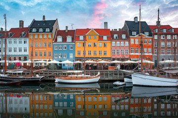 Poster Scandinavia Nyhavn at sunrise, with colorful facades of old houses and old ships in the Old Town of Copenhagen, capital of Denmark.