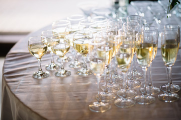 Festive table setting with champagne. champagne glasses close up