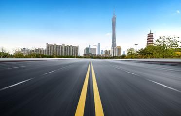 Empty road floor surface with modern city landmark buildings of guangzhou bund Skyline