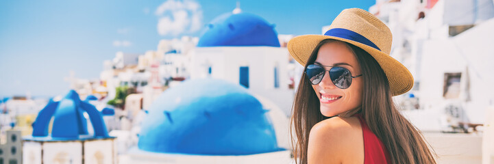 Fototapete - Summer travel tourist girl smiling on Santorini Europe holiday. Vacation panoramic banner landscape on the three blue domes.