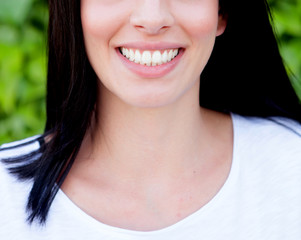 Woman showing her perfect teeth