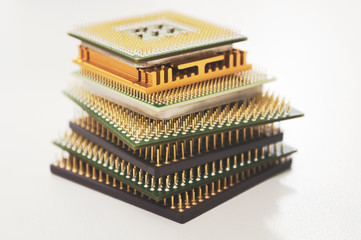 different computer processors on a white background stacked in a stack