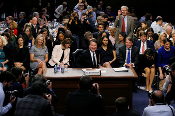 U.S. Supreme Court nominee Judge Kavanaugh smiles as he stands for first break in his confirmation hearing on Capitol Hill in Washington